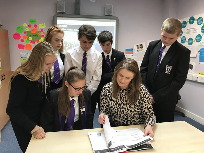 Wallace high School Pupils looking at Runrig unit with Mairi MacRitchie, Stòrlann.